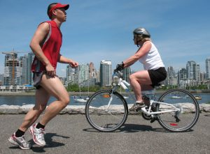 runner and cyclist vancouver seawall
